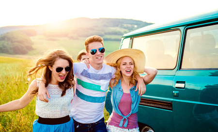 campervan: Young teenage hipster frieds with campervan against green nature and blue sky Stock Photo