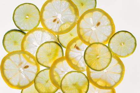 tranches d'agrumes de fruits motif abstrait de fond, les citrons frais et limes Banque d'images
