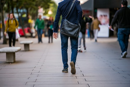 Unrecognizable manager walking in the street of London, back view Stock Photo