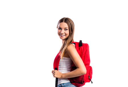 wise woman: Beautiful student in white singlet with red schoolbag. Studio shot on white background, isolated.
