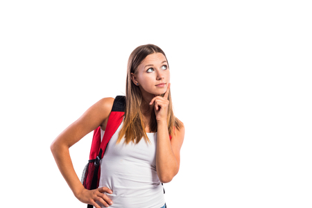 schoolbag: Beautiful student in white singlet with red schoolbag. Studio shot on white background, isolated.