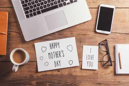 i love you sign: Happy mothers day and I love you sign. Office desk. Studio shot on wooden background.