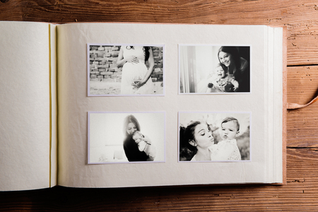 Mothers day composition. Photo album, black-and-white pictures. Studio shot on wooden background. Stok Fotoğraf