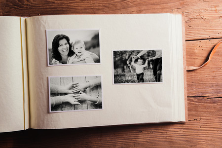 album: Mothers day composition. Photo album, black-and-white pictures. Studio shot on wooden background. Stock Photo