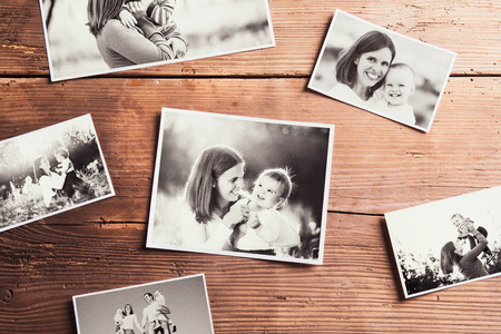 blackandwhite: Mothers day composition. Various black-and-white family pictures. Studio shot on wooden background. Stock Photo