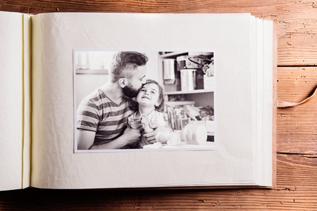 blackandwhite: Fathers day composition. Photo album, black-and-white picture. Studio shot on wooden background.