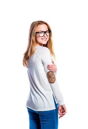 tight jeans: Teenage girl in jeans and white long sleeved sweatshirt, young woman, studio shot on white background, isolated