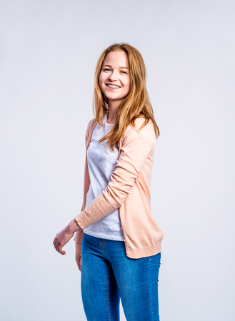 Teenage Girl In Jeans And Peach Coloured Cardigan, Young Woman ...