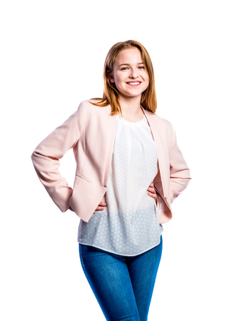 jeans apretados: Teenage girl in jeans, white blouse and pink jacket, young woman, studio shot on white background, isolated