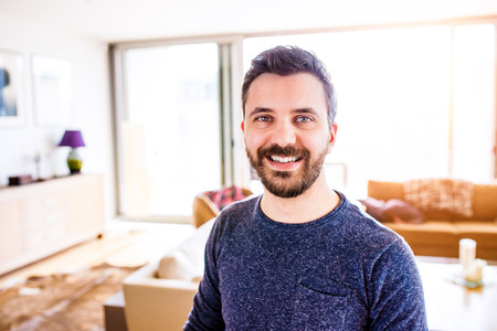 long sleeved: Handsome hipster businessman in blue long sleeved t-shirt, working from home, taking a break