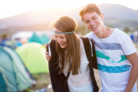 teen couple: Beautiful young couple at summer tent festival enjoying themselves Stock Photo