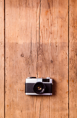 laid: Summer vacation composition. Vintage camera laid on table. Wooden background. Studio shot, flat lay. Copy space. Stock Photo