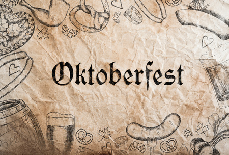 sketch drawing: Oktoberfest sign with various hand drawn symbols, paper background. Studio shot.
