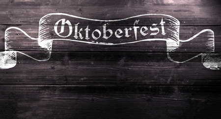 oktober: Oktoberfest chalk sign on textured board, copy space. Wooden background. Stock Photo