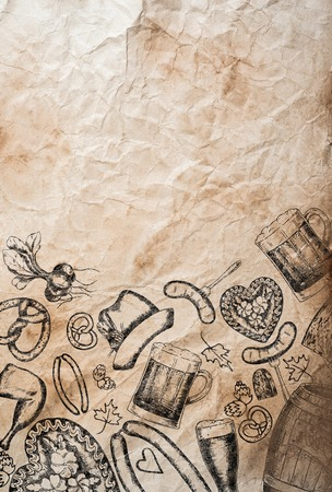 rumpled: Hand drawn Octoberfest symbols on old rumpled paper background. Copy space. Studio shot. Stock Photo