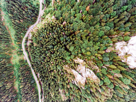 mala fatra: Aerial view of a road in the middle of coniferous forest, rocky hills. Mala Fatra, Slovakia.