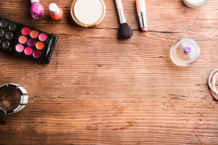 flat brush: Various make up products laid on table. Studio shot on wooden background. Flat lay, copy space.