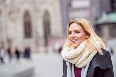 woman clothes: Beautiful young woman on a walk in historical centre of the city of Vienna, Austria. Winter.