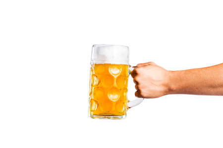 Hand of unrecognizable man holding a beer mug. Oktoberfest. Studio shot on white background, isolated. Copy space.