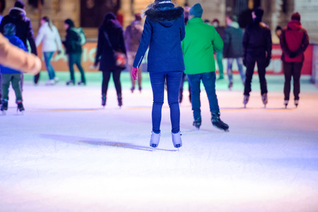 skating fun: People ice skating at night in historical centre of the city of Vienna, Austria. Winter. Stock Photo