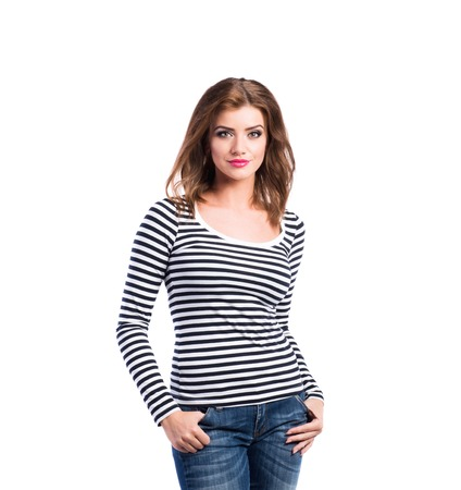 long sleeved: Beautiful young woman in jeans and striped long sleeved t-shirt, studio shot on white background, isolated Stock Photo