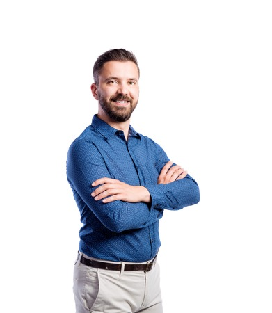 blue shirt: Young handsome hipster man in blue shirt, arms crossed. Studio shot on white background, isolated.