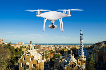 Close up of hovering drone taking pictures of park Guell in Barcelona, Spain.