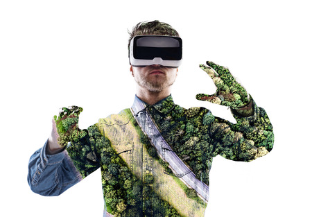 Double exposure. Man wearing virtual reality goggles. Forest. Tr Stock Photo