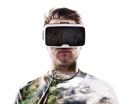 double game: Double exposure. Man wearing virtual reality goggles. Road. Stock Photo