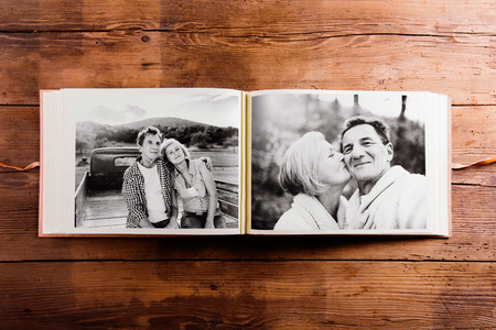 photo pictures: Photo album with black-and-white pictures of senior couple. Stock Photo