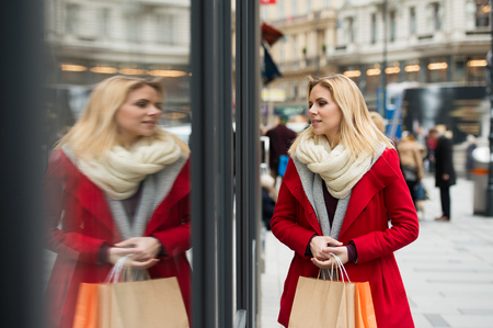 Woman window shopping in centre of the city. Winter