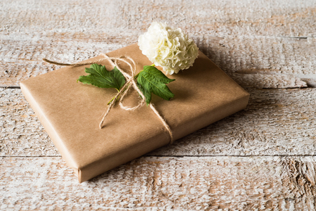 Present wrapped in brown paper lilac flower laid on it stock photo present wrapped in brown paper lilac flower laid on it stock photo picture and royalty free image image 71602230 mightylinksfo