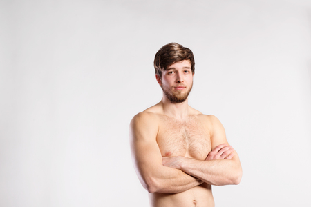 Handsome shirtless fitness man, arms crossed. Studio shot. Stock Photo