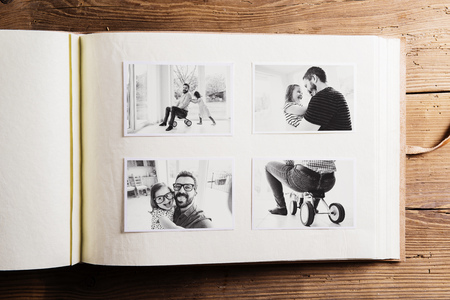 Fathers day concept. Photo album. Wooden background. photo