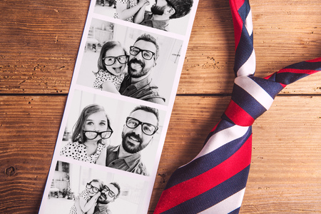 Pictures of father and daughter on table. Fathers day. Studio shot. photo