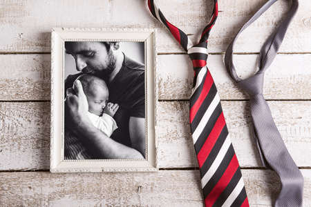 Picture of father holding baby daughter. Fathers day.