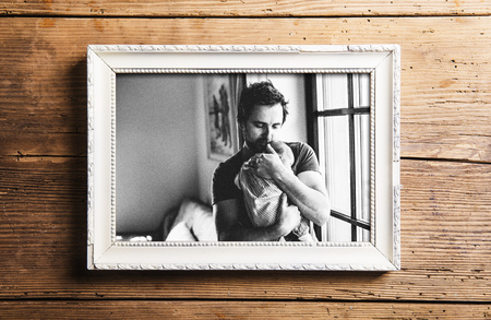 fondling: Picture of father holding baby daughter. Fathers day.