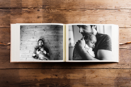 Photo album with pictures of father and baby girl. Fathers day. Stock Photo