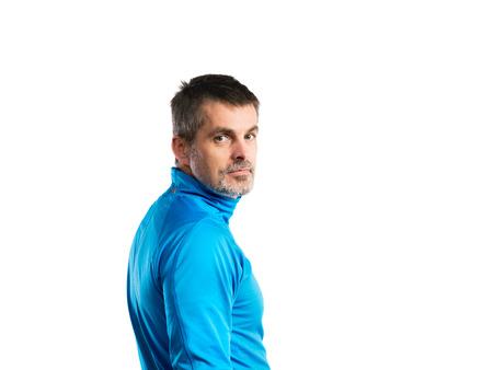 Mature hipster man in blue sweatshirt. Studio shot, isolated. Reklamní fotografie
