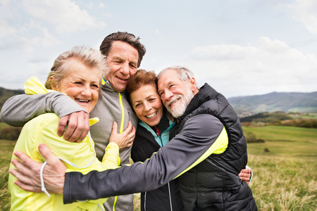 Group of senior runners outdoors, resting and hugging. Фото со стока - 81164279