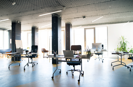 ceiling: The interior of big bright empty modern office after work. Stock Photo