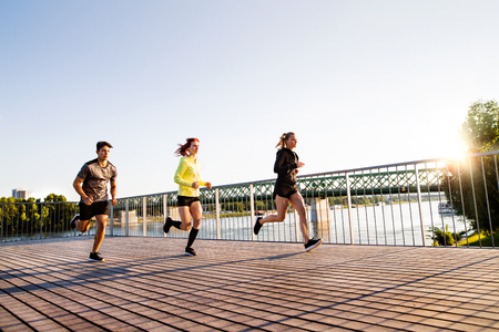 bratislava: Young athtletes in the city running at the river. Stock Photo