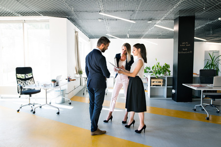 Business people in the office. Man and woman shaking hands. photo