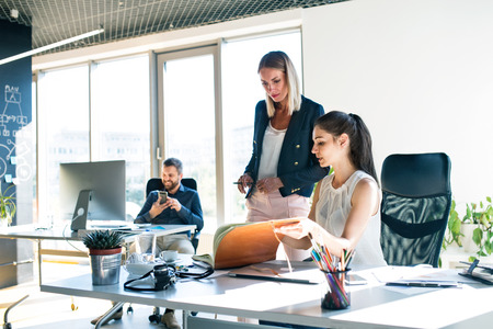 Three business people in the office working together. photo