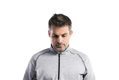 Mature hipster man in gray sweatshirt. Studio shot, isolated.