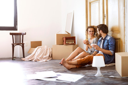 Young couple moving in a new house. Stock Photo