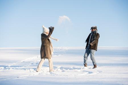 Beautiful senior couple on a walk in sunny winter nature