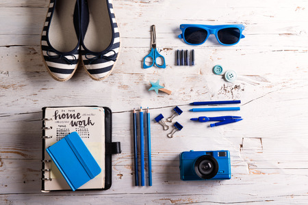 Desk with tablet and school supplies. Studio shot on white wooden background. Stok Fotoğraf