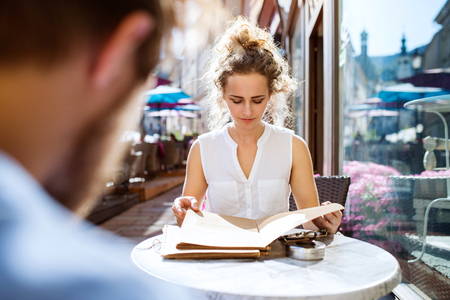 Young woman sitting in a cafe. Stock Photo