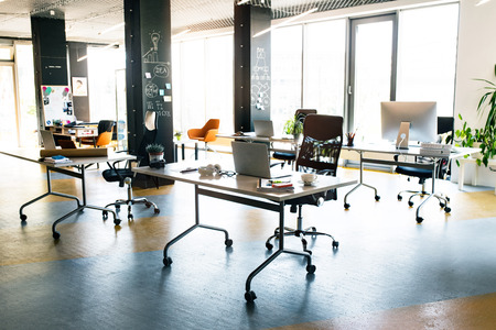 The interior of big bright empty modern office after work. Stock Photo